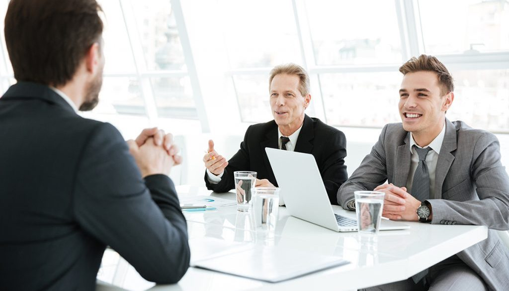 graphicstock-smiling-smart-business-people-working-on-difficult-financial-project-in-office_SI_U_vQ_2e-1024x683